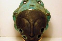 4 hole womanshead ocarina. Stoneware, raku fired.